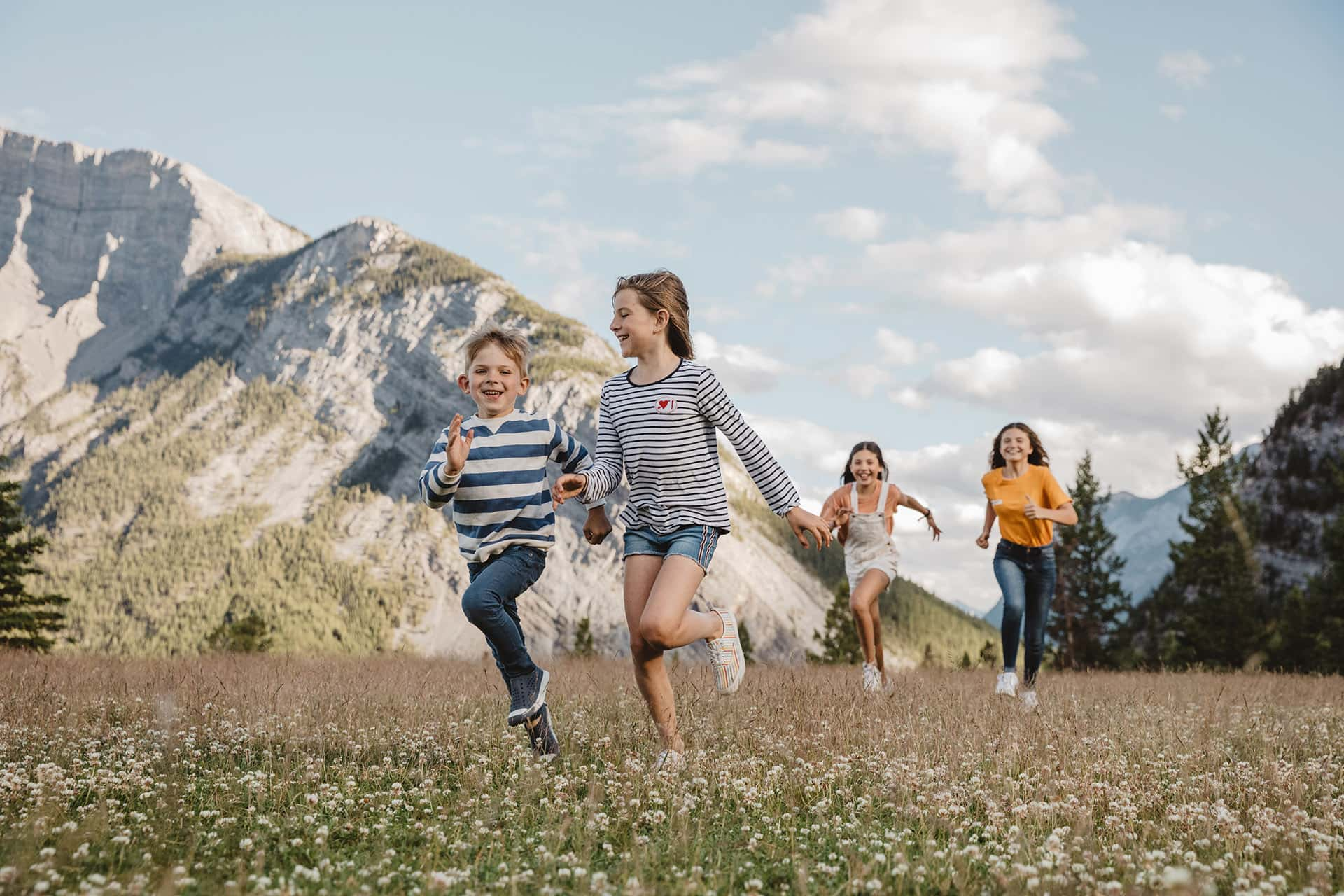 Family plays near Tunnel Mountain and Buffalo Mountain Lodge in Banff National Park