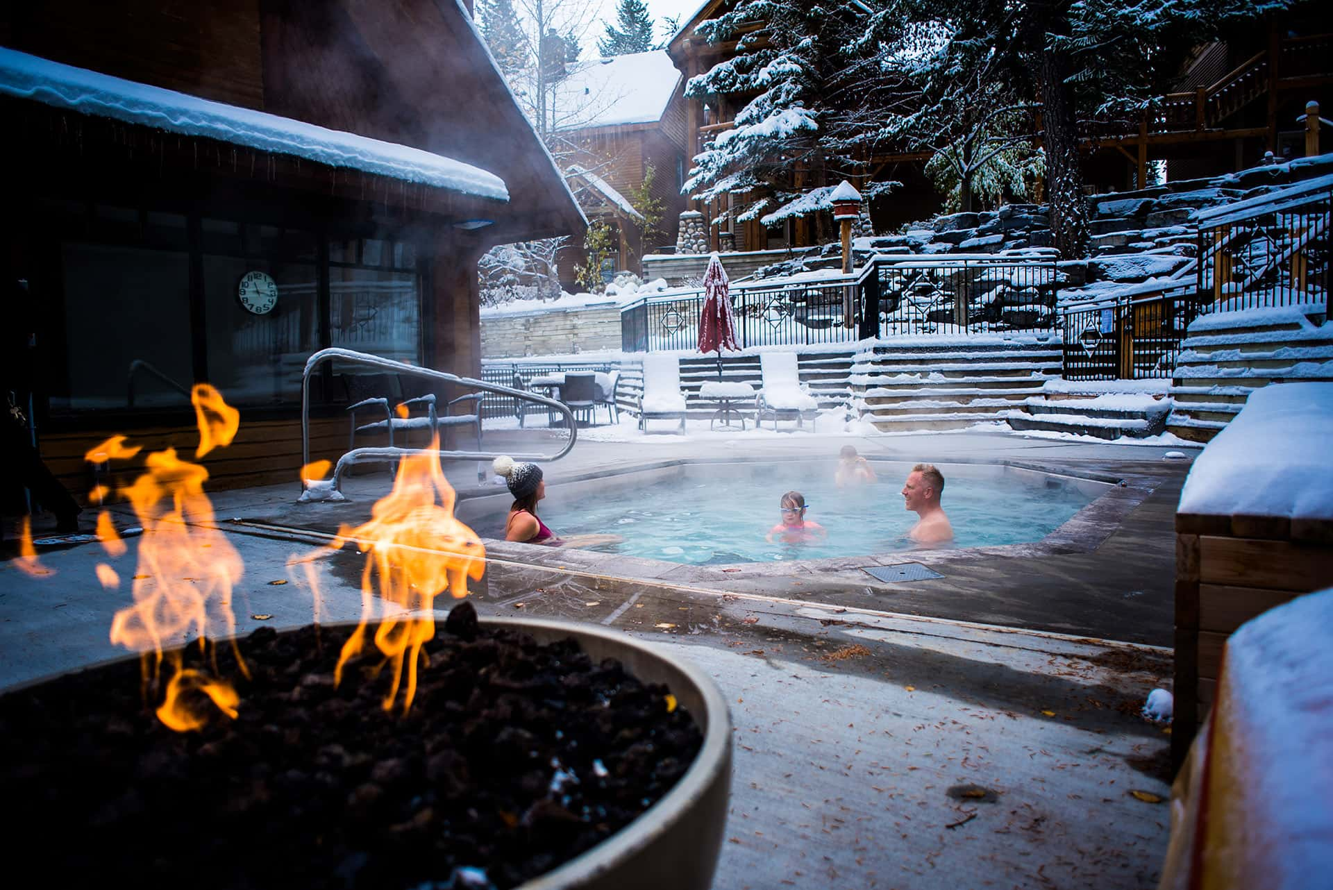 Family Enjoys Hot Tub at Buffalo Mountain Lodge in Banff National Park
