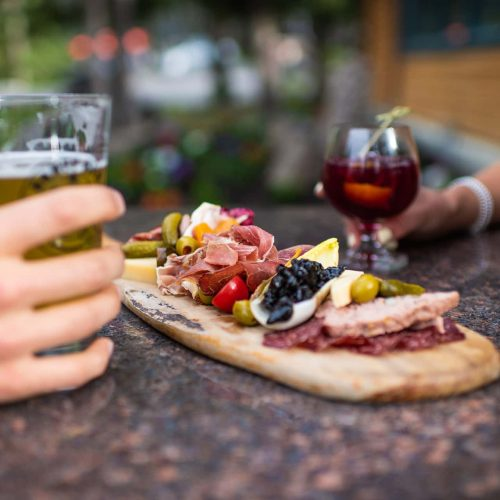 Charcuterie Board and Cocktails on Patio at Buffalo Mountain Lodge in Banff National Park